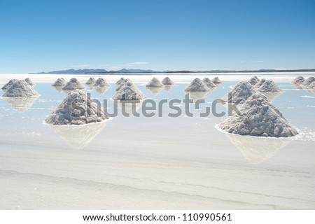 This image shows salt piles on Bolivia's Salar De Uyuni - stock photo