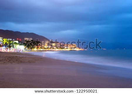 This image shows the beach at sunset in Puerto Vallarta, Jalisco, Mexico - stock photo