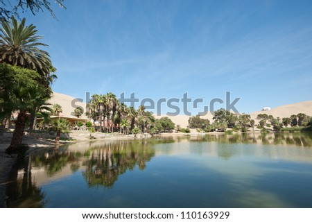This image shows the oasis town of Huacachina, Peru - stock photo