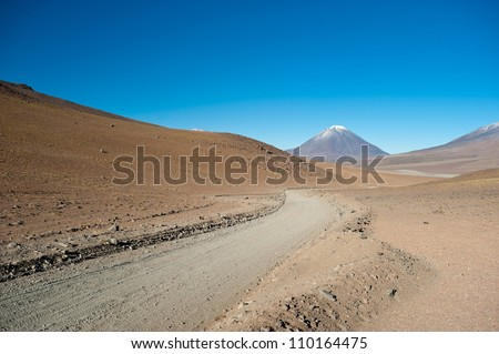 This image shows the road to  Volcano Lincancabur in Bolivia - stock photo