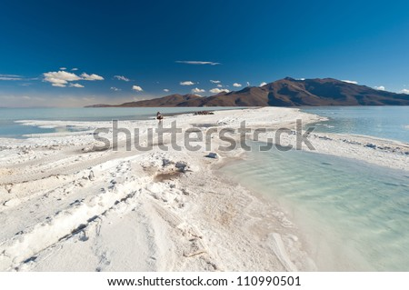 This image shows water pooling on  Bolivia's Salar De Uyuni - stock photo