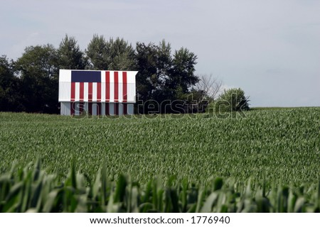 This Iowa corn farmer painted his entire barn with a flag motif. - stock photo