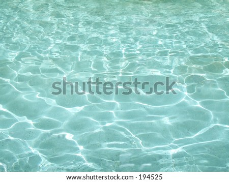 This is a background shot of some crystal clear aqua colored water.