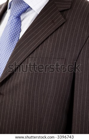 This is a close up of businessman wearing a tie, shirt, and suit.