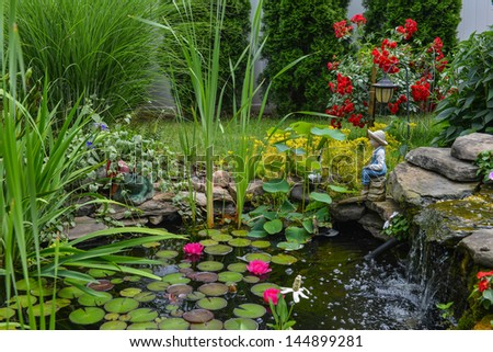 This is a close view of the water pond feature with the statue - stock photo