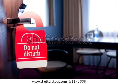 "This is a closeup of a ""do not disturb"" sign - stock photo"