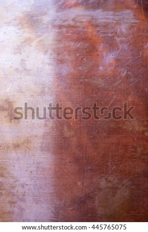 This is a closeup photograph of an old textured rusty copper plate