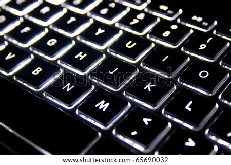 This is a computer keyboard with illuminated backlight. - stock photo