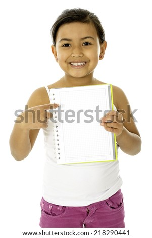 This is a cute and a young girl, she is pointing something on her book  - stock photo