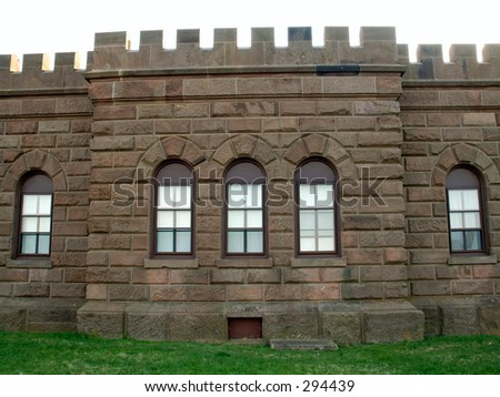 This is a detailed shot of a castle wall. - stock photo