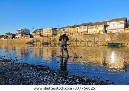This is a fisherman in a river. Morning Kyoto Japan - stock photo