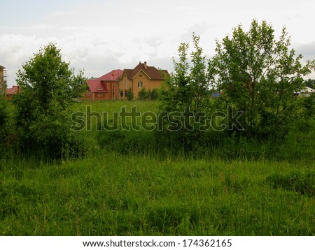 This is a house, trees  and green grass