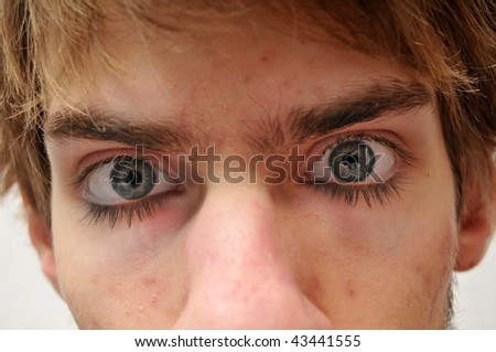 This is a long exposure of an eye open and closed at the same time. You can see the eyelashes at the top and bottom of the eye. - stock photo