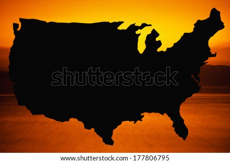This is a map of the United States, silhouetted in black against a yellowish orange background. - stock photo