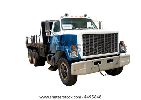 This is a mid 1980's heavy duty flatbed truck viewed from the front corner. isolated on white.