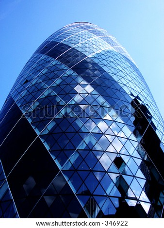 This is a modern office building in London called the Gherkin. - stock photo