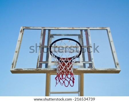 this is a old basketball hoop on blue sky background - stock photo