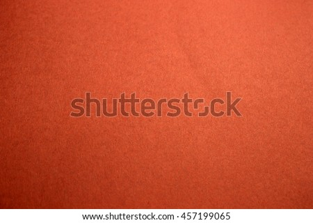 This is a photograph of a Bright Neon Orange construction paper background