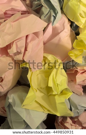 This is a photograph of crumpled textured Blue,Yellow and Pink construction paper background