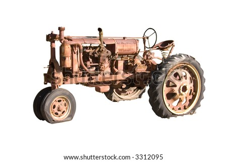 This is a picture of a rusted, non-working antique farming tractor isolated on white.