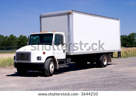 This is a picture of a typical six wheel city delivery cargo vehicle with a blank white van box.