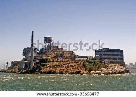 This is a picture of Alcatraz - the famous former federal prision in San Francisco Bay known as The Rock. - stock photo