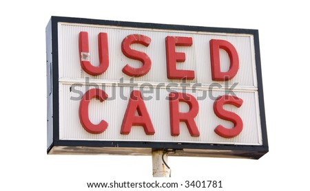 This is a picture of an old used cars sign with red letters, isolated on a white background. - stock photo