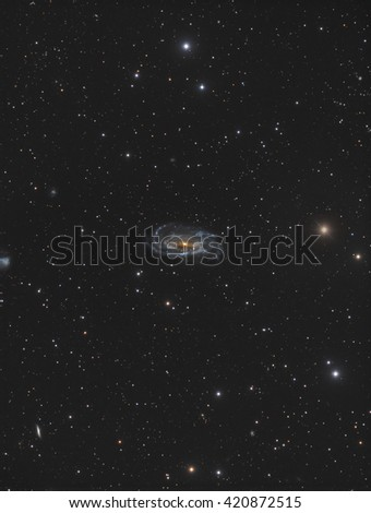 This is a picture of NGC5033. It is an inclined spiral galaxy about 50 million light years away in the constellation Canes Venatici. - stock photo