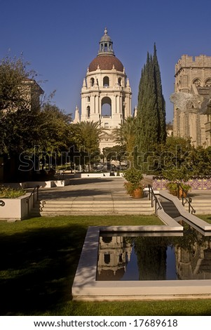 This is a picture of the Pasadena City Hall with its reflection in a reflecting pond. - stock photo