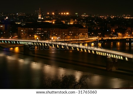 This is a Rainbow bridge by night on Danube river between the Petrovaradin and city of Novi Sad in Serbia.
