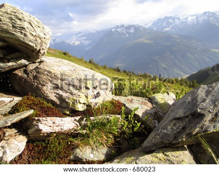 This is a ruined part of stone fence in mountains - stock photo