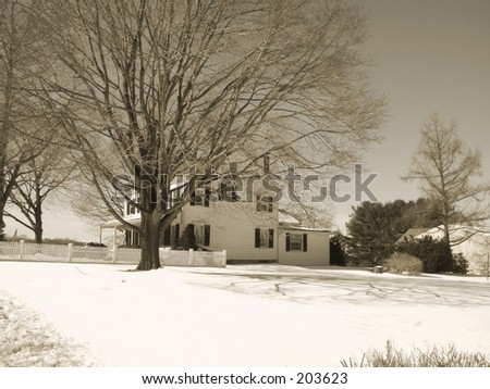 This is a sepia toned photo of a country home with a white picket fence. - stock photo