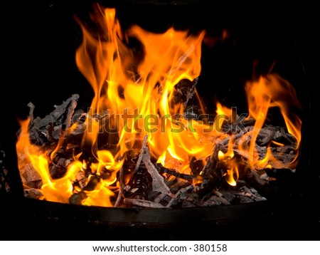 This is a shot of a campfire in the night - stock photo