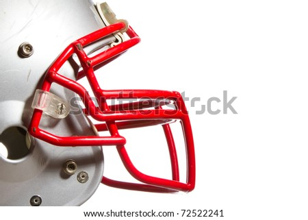 This is a side view shot of an old scratched up football helmet. Shot on an isolated white background. - stock photo