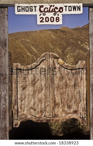 This is a sign for Calico, California, a ghost town and San Bernardino County park. - stock photo