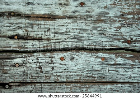 This is a textured background shot of weathered wood with some nail head. - stock photo