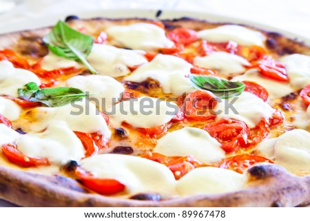 This is a true Italian Pizza. Traditional Pizza Margherita served in a Capri's restaurant, Naples Gulf, Italy. - stock photo
