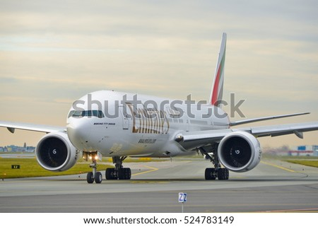 This is a view of Emirates plane Boeing 777-300ER registered as A6-EPR on the Warsaw Chopin Airport. November 4, 2016. Warsaw, Poland.