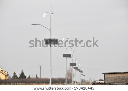 This is a view of lamps powered by solar and wind energy. - stock photo