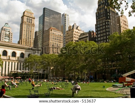 This is a view of people relaxing in Bryant Park in Manhattan on a nice sunny Summer day. - stock photo