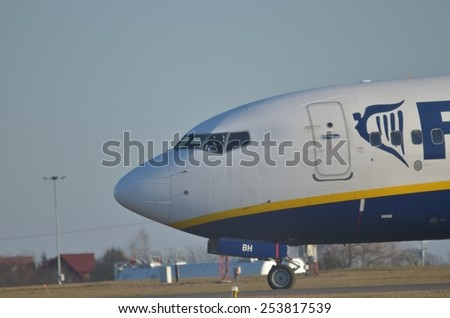 This is a view of Ryanair plane Boeing 737 8AS(WL) registered as EI-EBH over the Lublin Airport. February 17, 2015. Lublin Airport in Swidnik, Poland.
