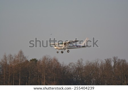 This is a view of small plane Cessna registered as SP-GRM landing on the Lublin Airport. February 20, 2015. Lublin Airport in Swidnik, Poland