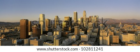 This is a view of the Harbor Freeway in Los Angeles with rush hour traffic at sunset. There are streaked lights from the cars on the freeway. - stock photo