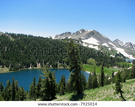 This is a view of two lakes from the side of a mountain in the Sierra Nevadas.