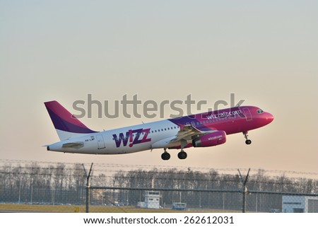 This is a view of Wizzair plane Airbus A320-232(WL) registered as HA-LWP on the Lublin Airport. March 20, 2015. Lublin Airport in Swidnik, Poland.