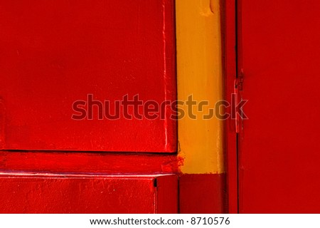 This is an abstract photograph of a red door in downtown San Francisco