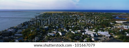 This is an aerial view of Cape Cod. We see the ocean on the left hand side and a nice New England town on the right. - stock photo