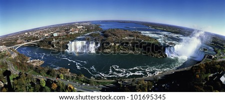 This is an aerial view of Rainbow Bridge, the American Falls and Horseshoe Falls. - stock photo