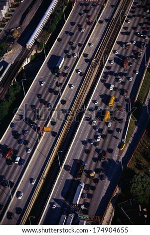 This is an aerial view of the Interstate Highway 90/94 during rush hour traffic. It is the morning rush hour during summer. - stock photo