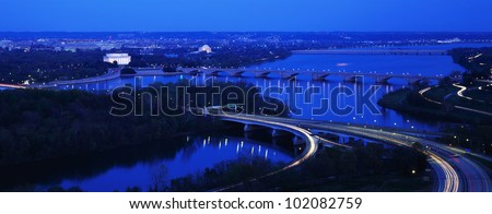 This is an aerial view of Washington, DC. The Potomac River runs through the center with the Key Bridge at right . - stock photo